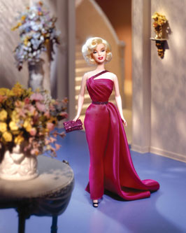 """Though her life was as brief as a candle in the wind, the legend of Marilyn lives on. In Mattel's tribute to """"How to Marry a Millionaire"""", the screen goddess is vibrant and delectable in a magenta one-shouldered evening gown plus a coral bathing suit and cover-up. Twice the Marilyn for twice the thrills! This special package is priced at $59.95."""