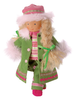 "The ""Mini It's Me"" Winter Child is 10 inches tall and priced at $59. The doll is dressed in a green corduroy outfit, trimmed with fur. Her hem is decorated with two rows of lace. The Winter Child is a Waldorf Doll."