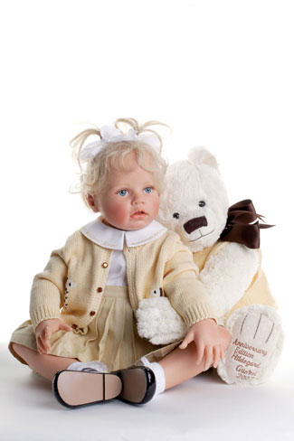 """In celebration of her 35th anniversary in the industry, Günzel created """"Vanilla."""" Dressed in Sunday finery, the doll hugs her teddy, whose paw is inscribed with """"Anniversary Edition Hildegard Gunzel 2007."""" The resin piece is limited to an edition of 135 worldwide."""