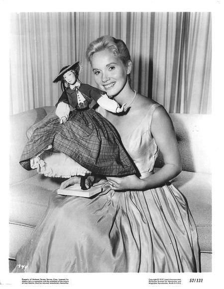 Eva Marie Saint holding a doll