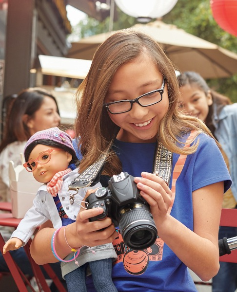 An aspiring stop-motion vlogger carries her Z doll.