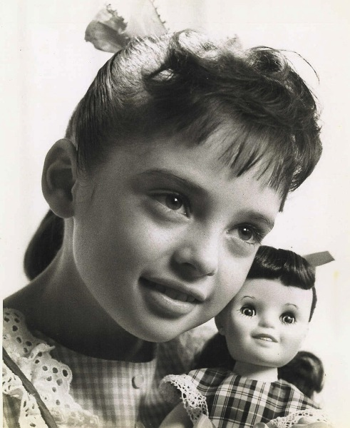 Young Angela and one of her doll likenesses.