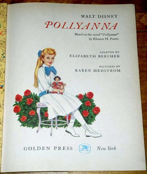 Pollyanna embracing the doll on the book's title page.