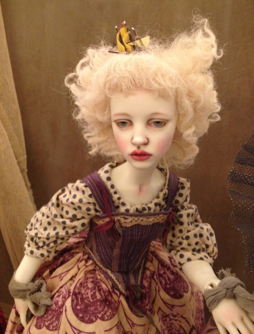 Antique creations reflect her past as a doll costume designer