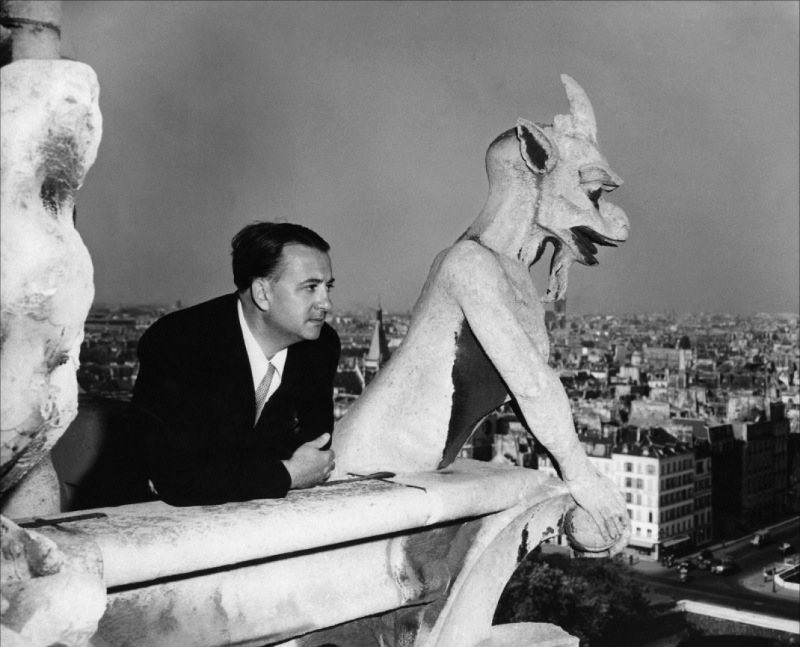 Director Jacques Tourneur, posing with Notre Dame's gargoyles
