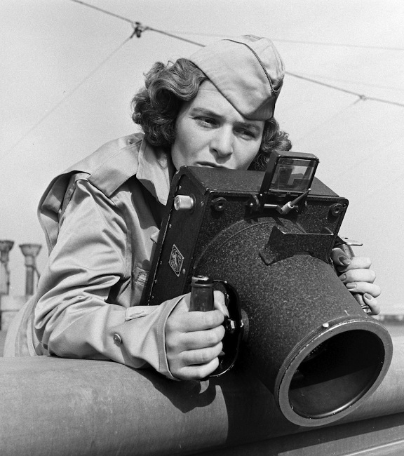 Margaret Bourke-White, legendary photographer, taking aim during wartime. Courtesy of Time Magazine Archives