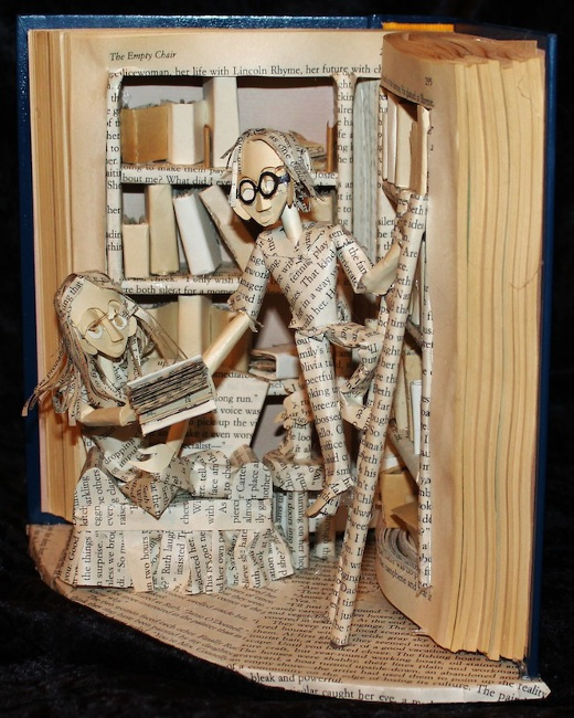 Jodi Harvey-Brown sculpted this library scene from a school's old reference book.