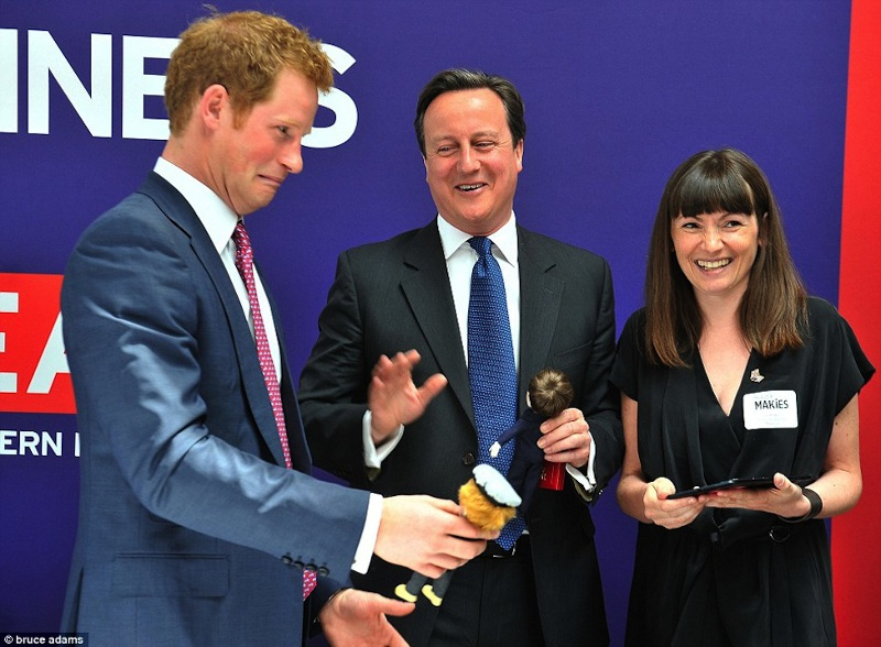Harry meets his MAKIES doll and makes a face, Courtesy of Daily Mail/Bruce Adams