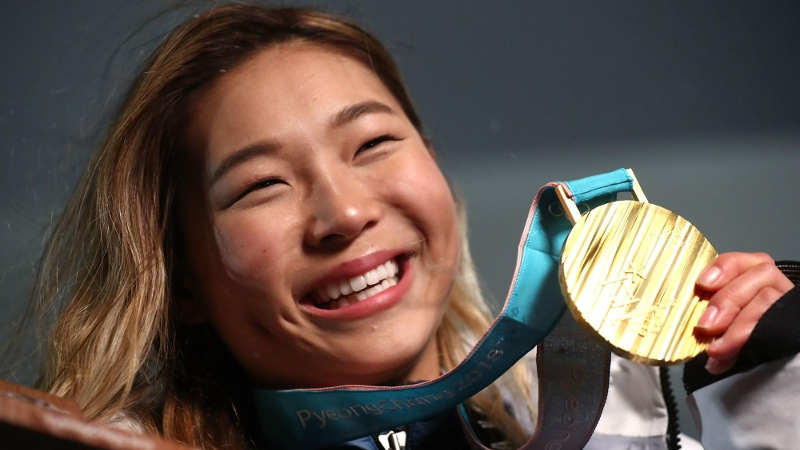 Chloe Kim with her first Olympic Gold