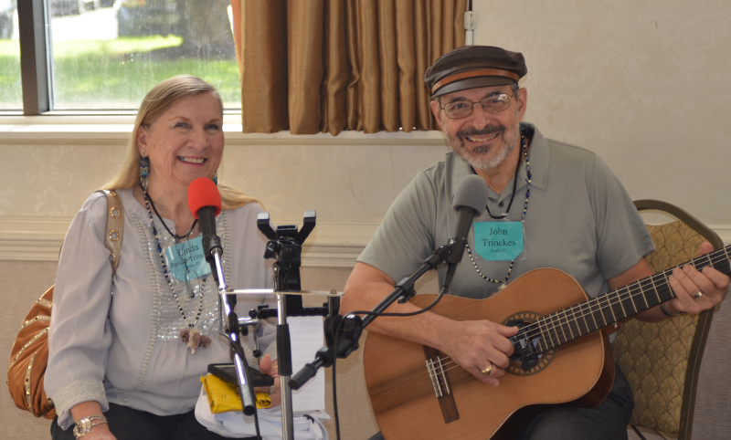 Artist Linda Trinckes and her husband John sing doll and teddy bear songs, which they composed, to entertain those waiting for the doors to open on the Quinlans' Saturday Show & Sale.