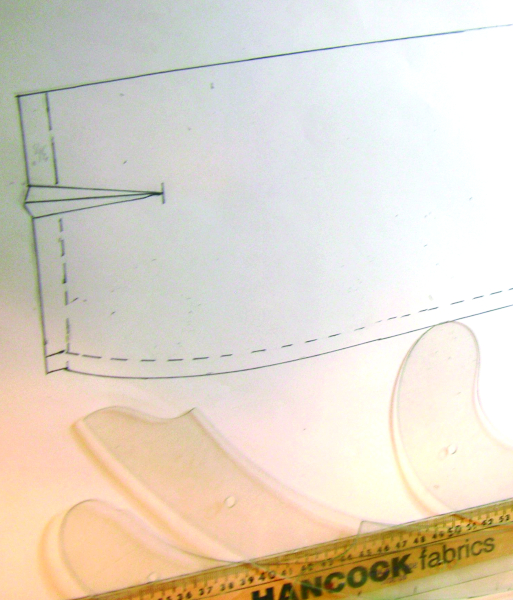 Refining the skirt pattern. The drafting tools shown here make it easier to get a perfect line.