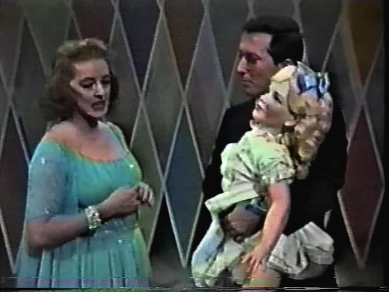 Bette Davis and Andy Williams and doll