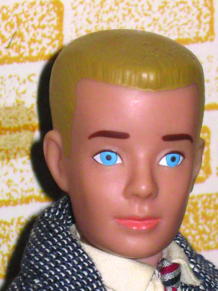 The second version of Ken from 1962 had a molded crew cut in both brunette and blond versions. Later models would feature bendable knees.